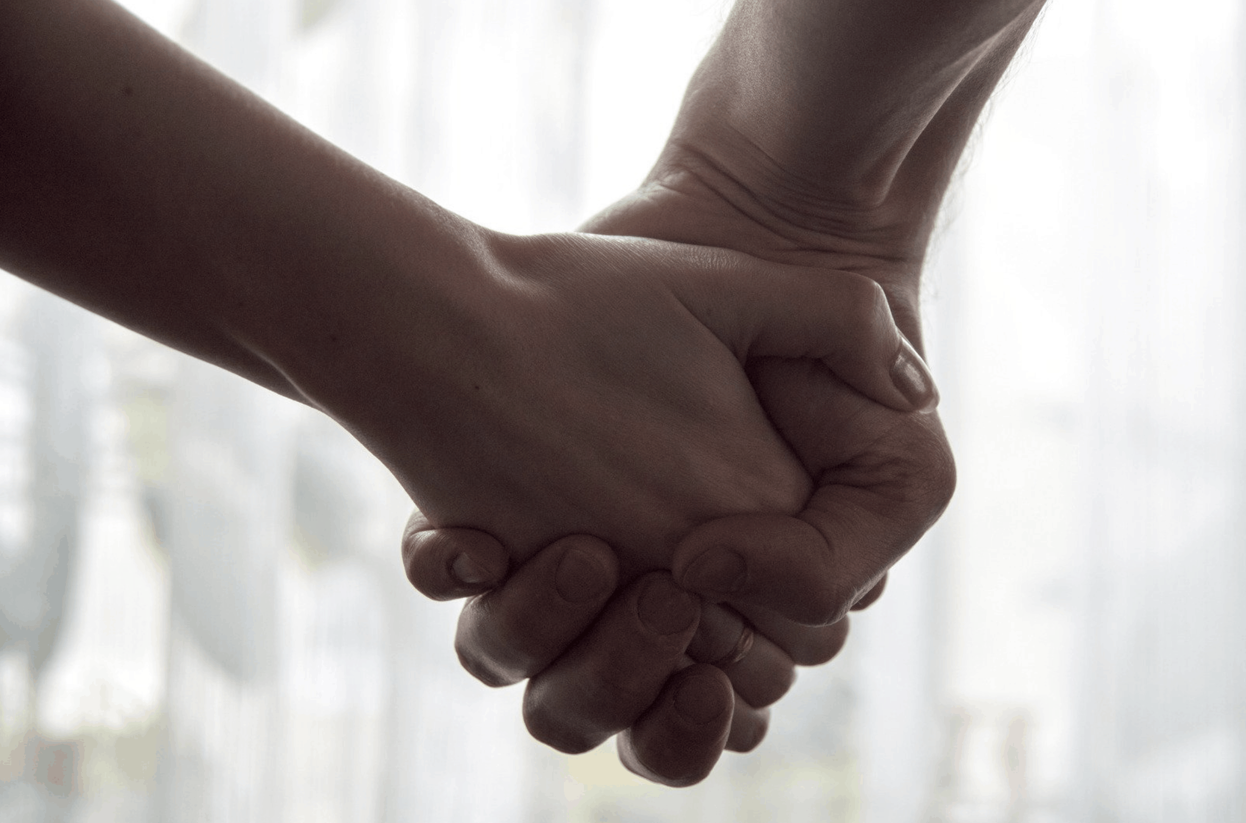 holding hands for suicide prevention